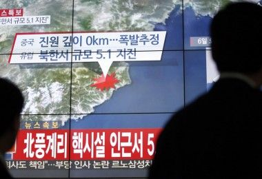"People walk by a screen showing the news reporting about an earthquake near North Korea's nuclear facility, in Seoul, South Korea, Wednesday, Jan. 6, 2016. South Korean officials detected an ""artificial earthquake"" near North Korea's main nuclear test site Wednesday, a strong indication that nuclear-armed Pyongyang had conducted its fourth atomic test. North Korea said it planned an ""important announcement"" later Wednesday. The letter read ""5.1 Earthquake near North Korea's nuclear facility."" (AP Photo/Lee Jin-man)"