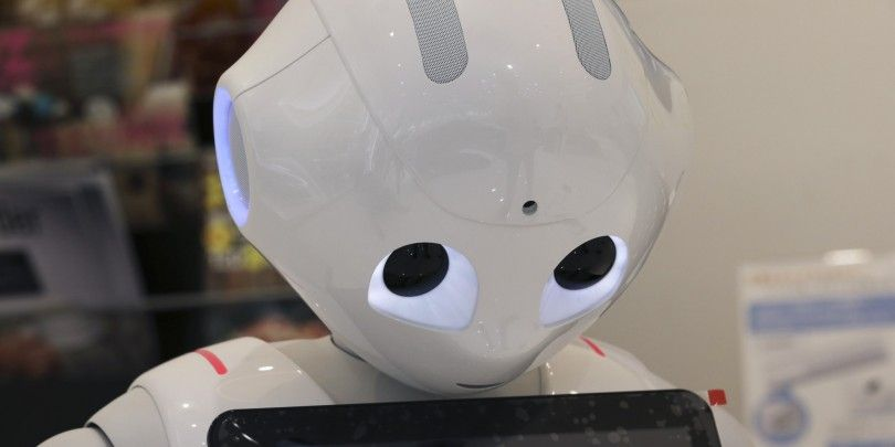 "Humanoid Robot ""Pepper"" is displayed at SoftBank Mobile shop in Tokyo, Friday, June 6, 2014. The 121 centimeter (48 inch) tall, 28 kilogram (62 pound) white Pepper, which has no hair but two large doll-like eyes and a flat-panel display stuck on its chest, was developed jointly with Aldebaran Robotics, which produces autonomous humanoid robots. (AP Photo/Koji Sasahara)"
